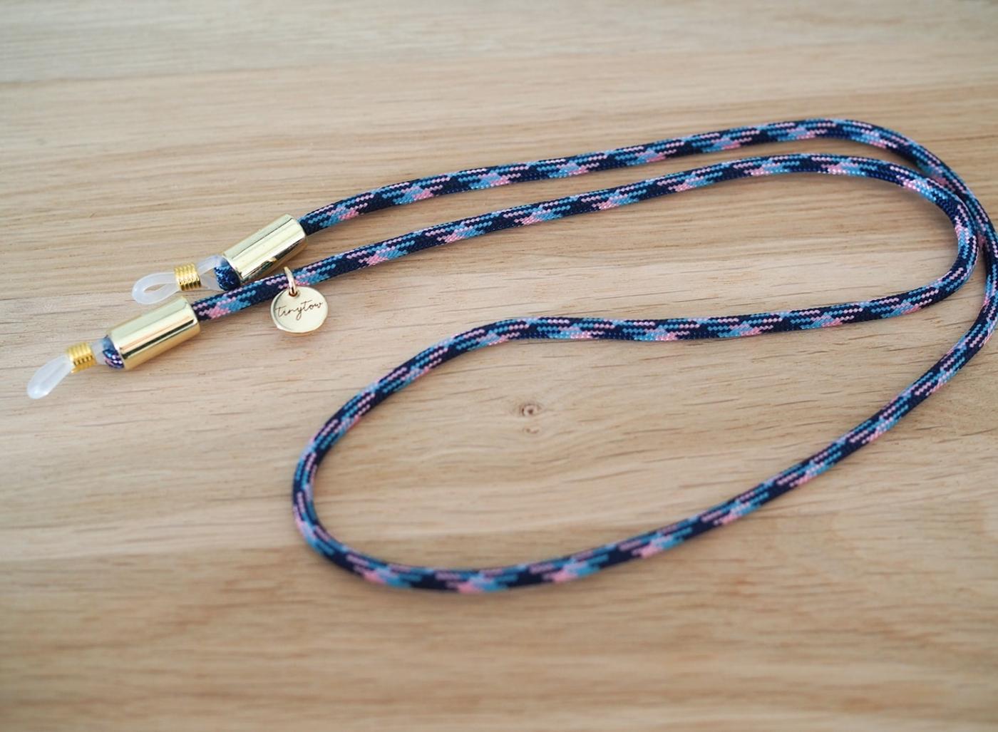 Gemustertes Brillenband ind blau/rosa mit goldenen Details