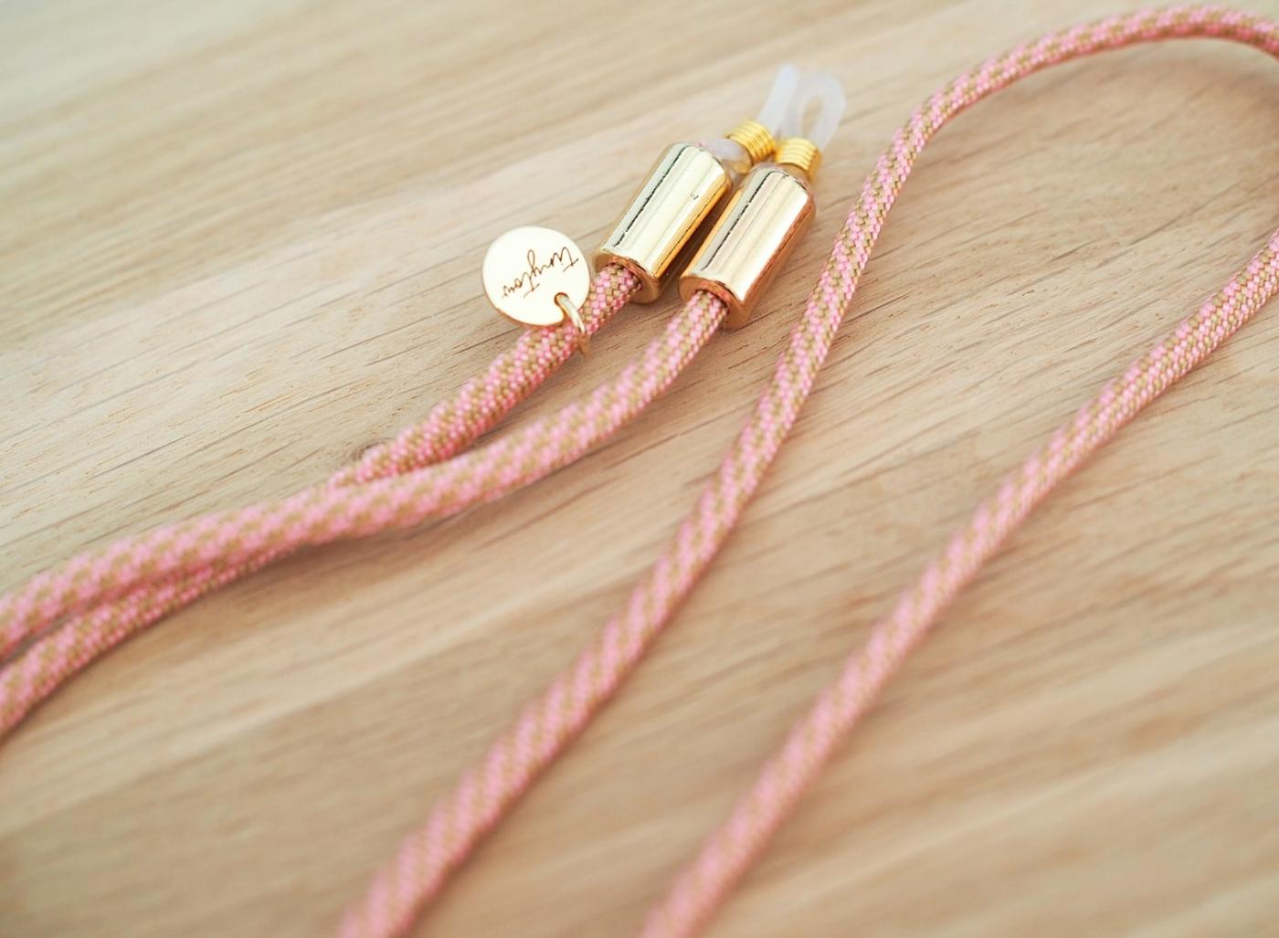 Gemustertes Brillenband in rosa mit goldenen Details