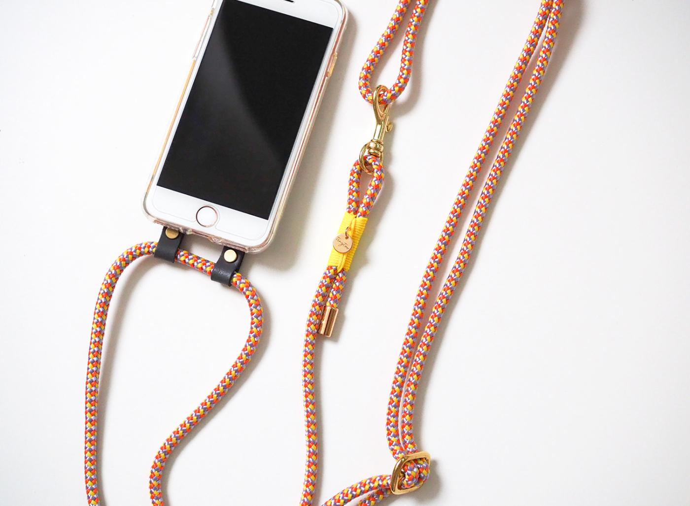Handyhülle zum Umhängen - Crossbody Handytau in gelb/orange für alle iPhone Modelle.